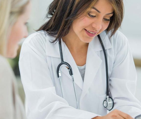 Doctor using a tablet to explain results