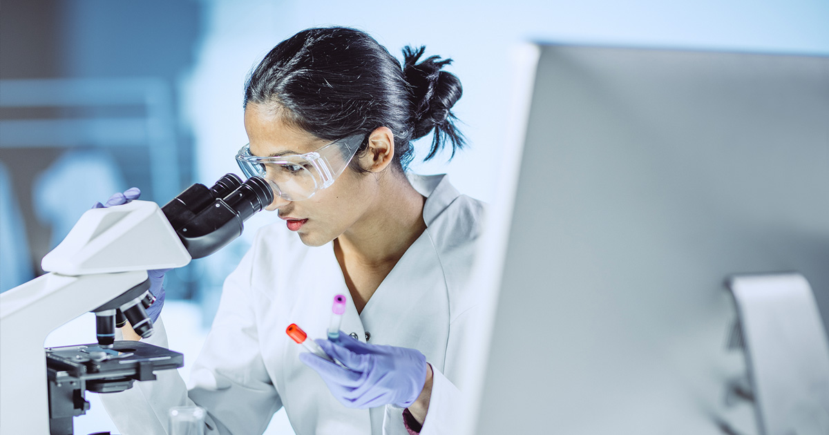 Female scientist working with a microscope 2