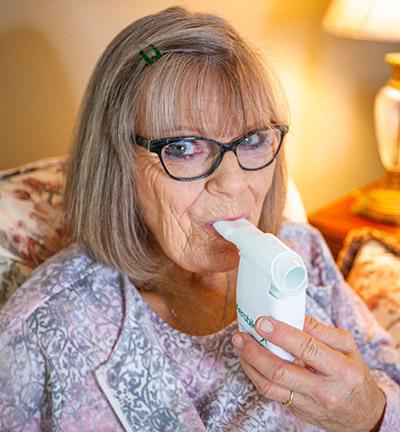 Patty Blasing using her inhaler