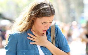 Woman having breathing troubles