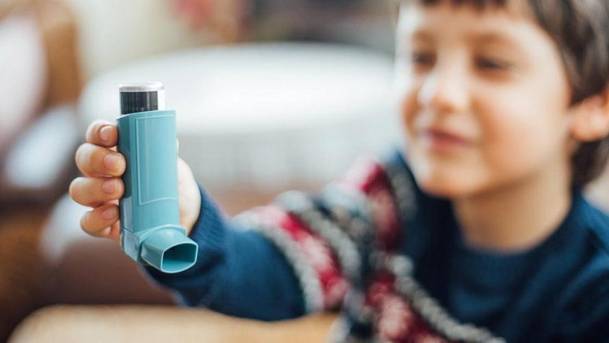 Young boy with an inhaler