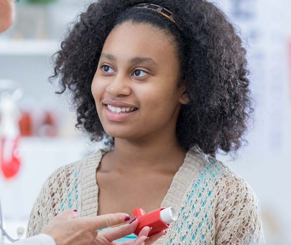 Young woman learning about her new inhaler