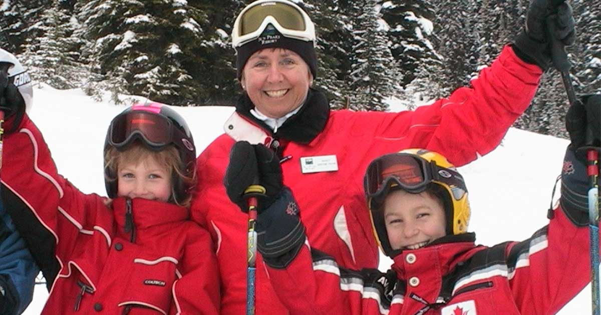 Nancy Greene Raine with two other young skiiers