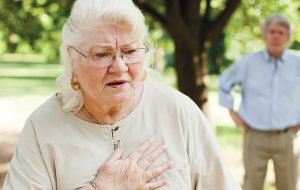 Senior woman experiencing chest pains