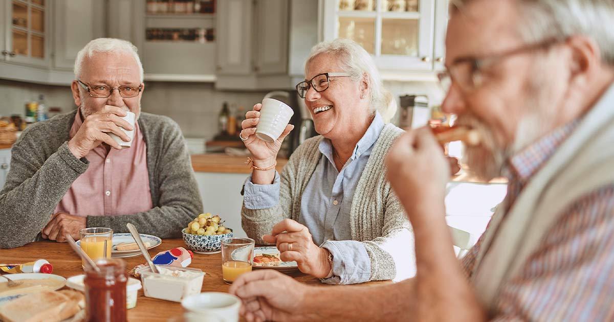 Seniors eating breakfast together