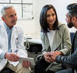 Doctor meeting with two patients
