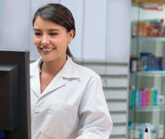 Female pharmacist working at desk