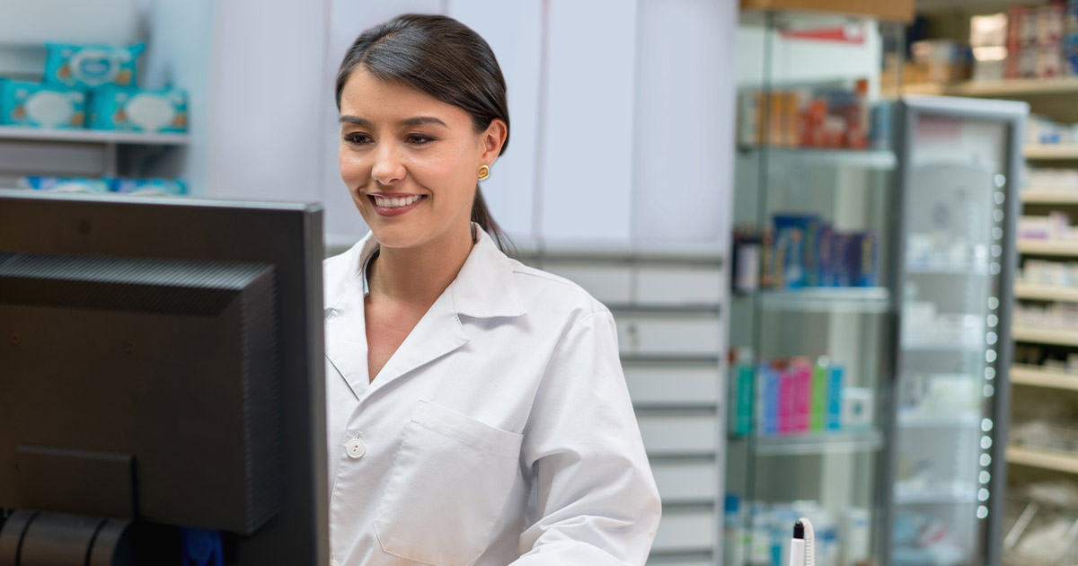 Female pharmacist working at desk