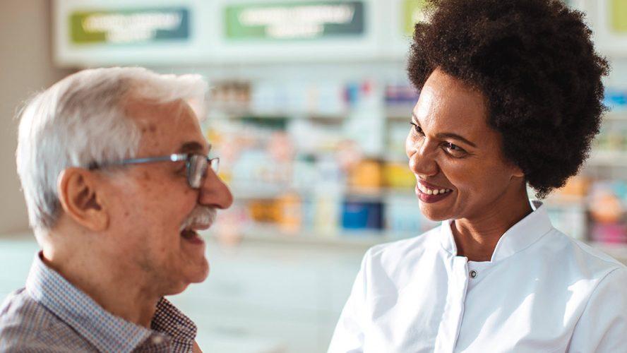Pharmacist helping an elderly man