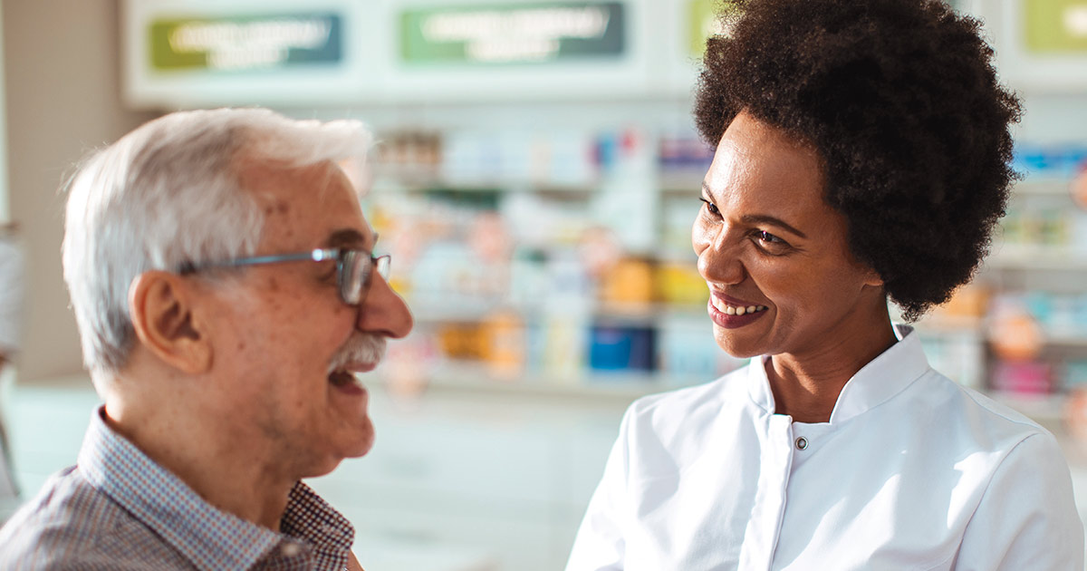 Pharmacist helping an elderly man
