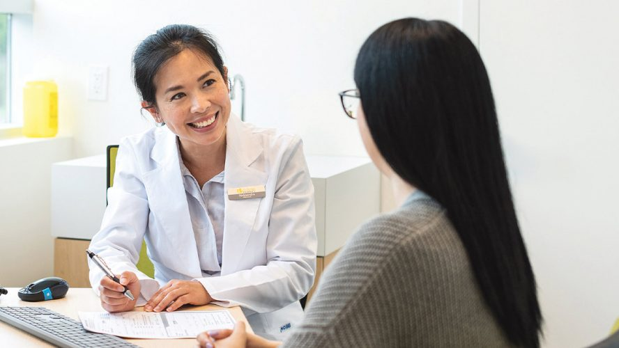 Pharmacist helping patient with paperwork