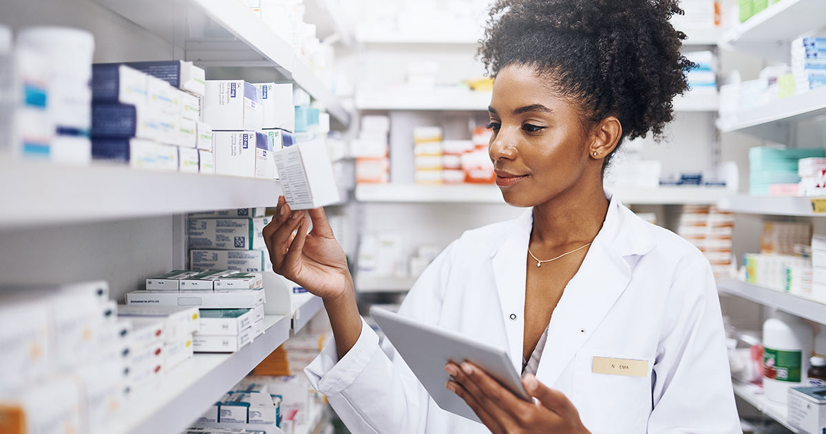Pharmacist using tablet in the stock room