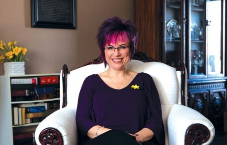 Bonnie Durling smiling in an armchair