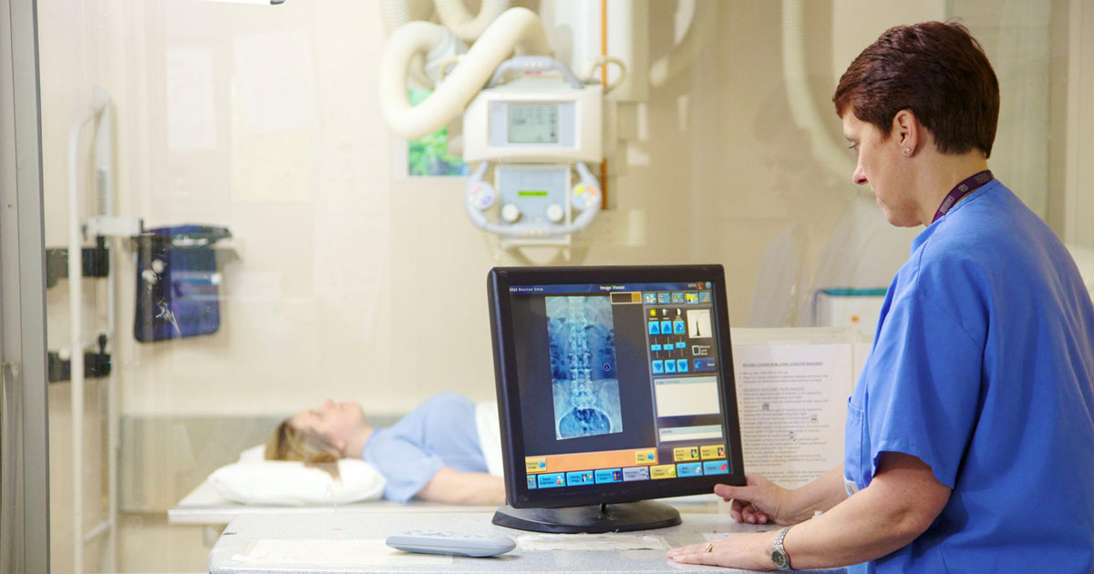 Medical radiation technologist working with a patient