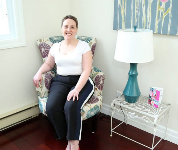 Wanda Deschamps sitting and smiling in her Liberty Co office