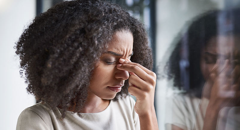 Woman experiencing a painful migraine