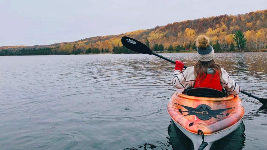 Woman kayaking on a lake