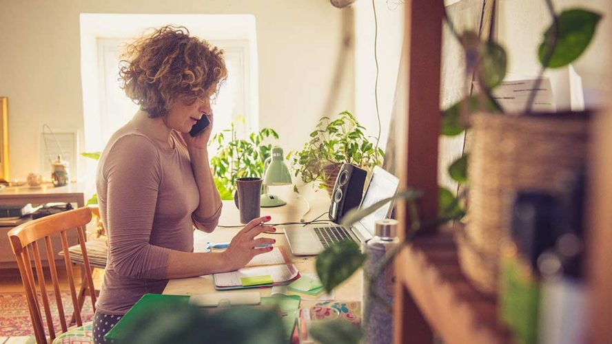Woman on the computer and phone at home