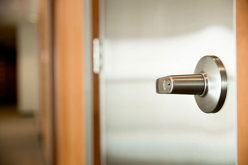 Close-up of a doorknob to an office