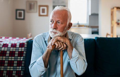 Elderly man sitting alone at home