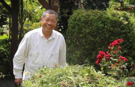 Mario Gregorio working in his garden