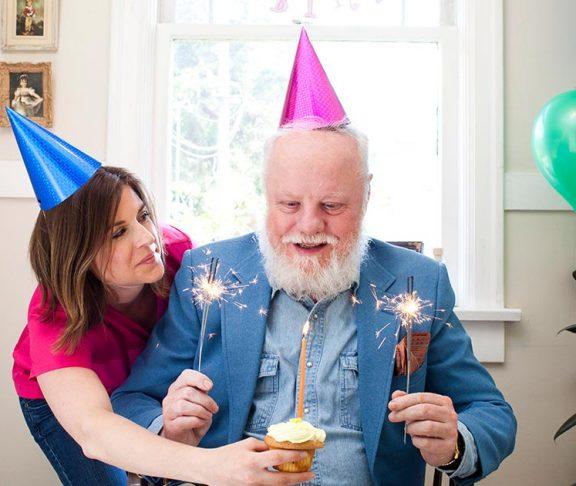 Senior man at home loving his birthday