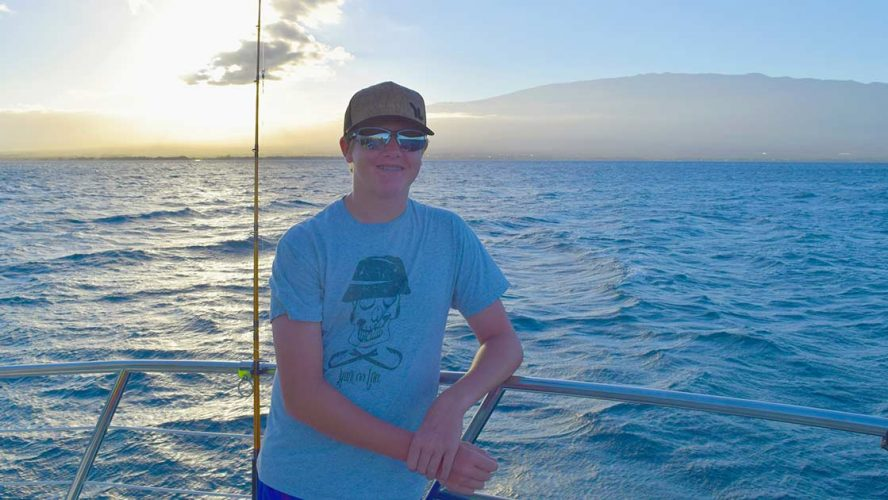 Blake Crane smiling on a boat