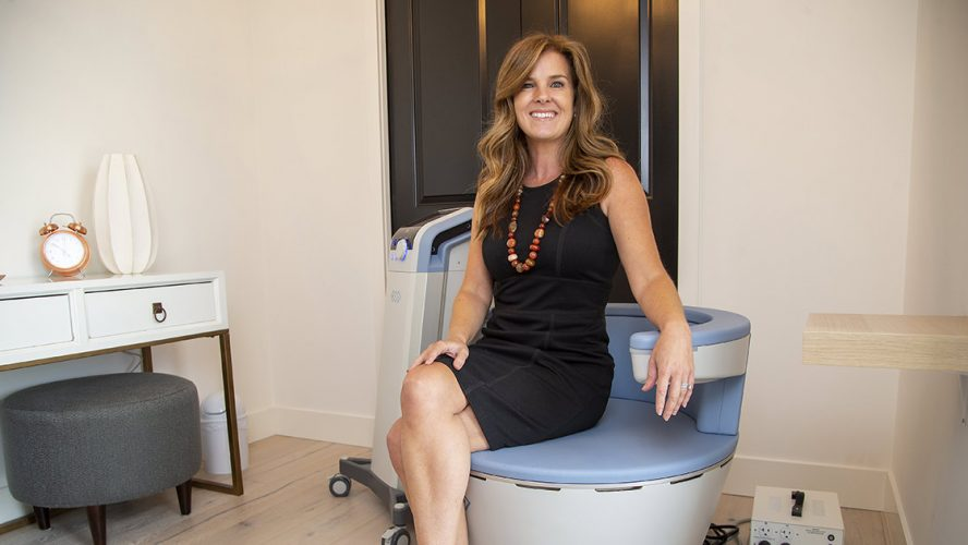 Erin Craven posing with a UROSPOT BTL EMSELLA Chair