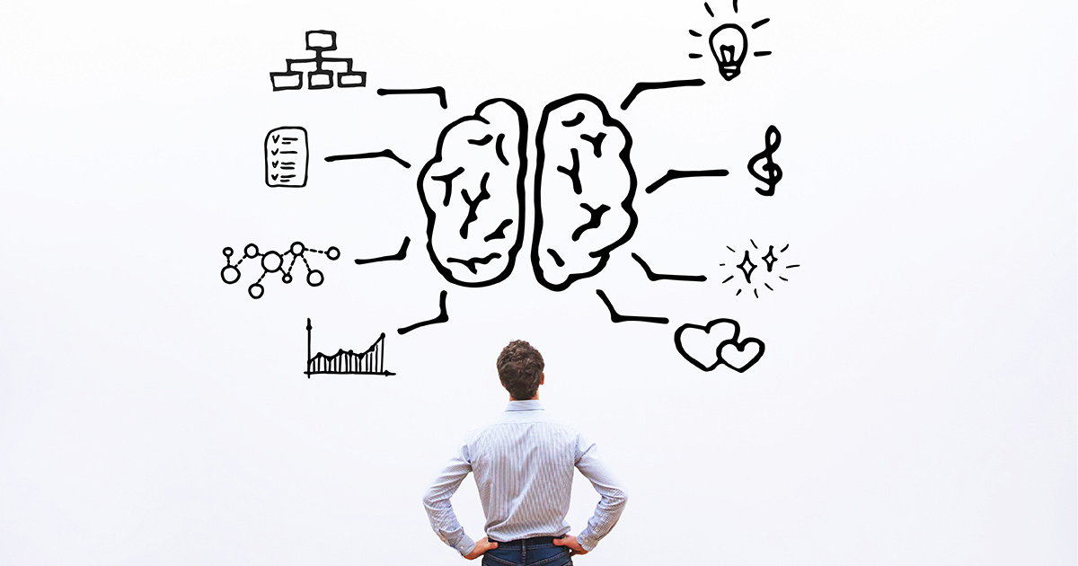 Man looking up at an illustration of a brain