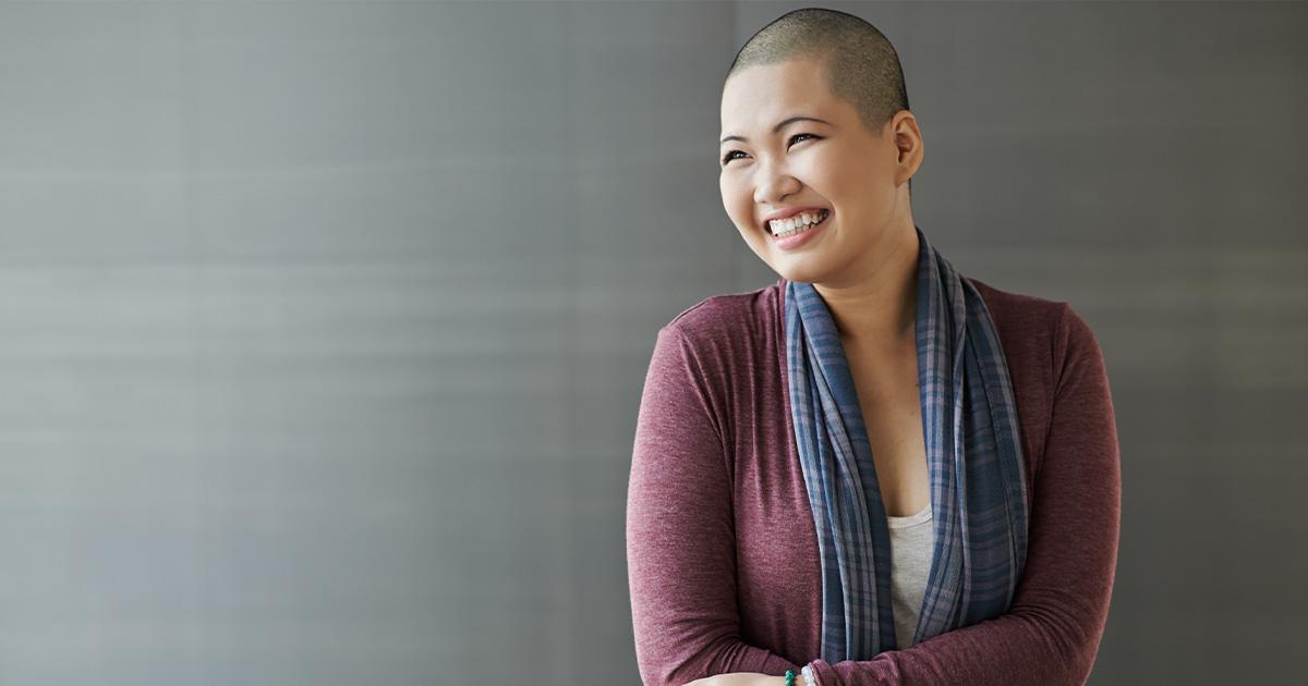 Smiling breast cancer survivor