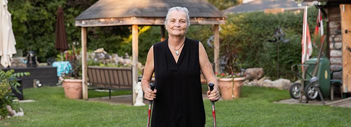 Suesanne Polzin walking in her yard