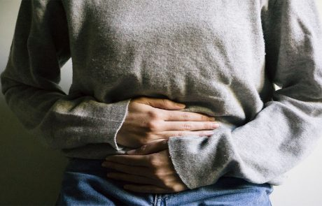 Close-up of person clutching their midsection