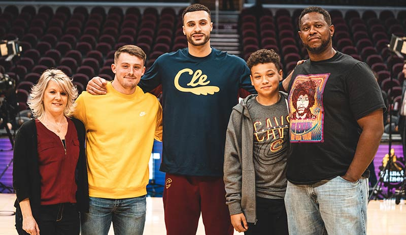Larry Nance Jr and his family at a basketball court