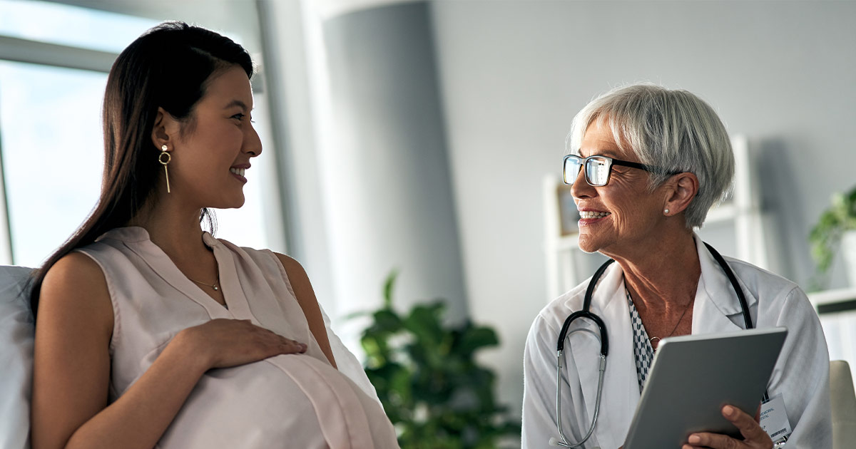 Pregnant woman talking with doctor