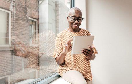 Senior woman using a digital tablet at home