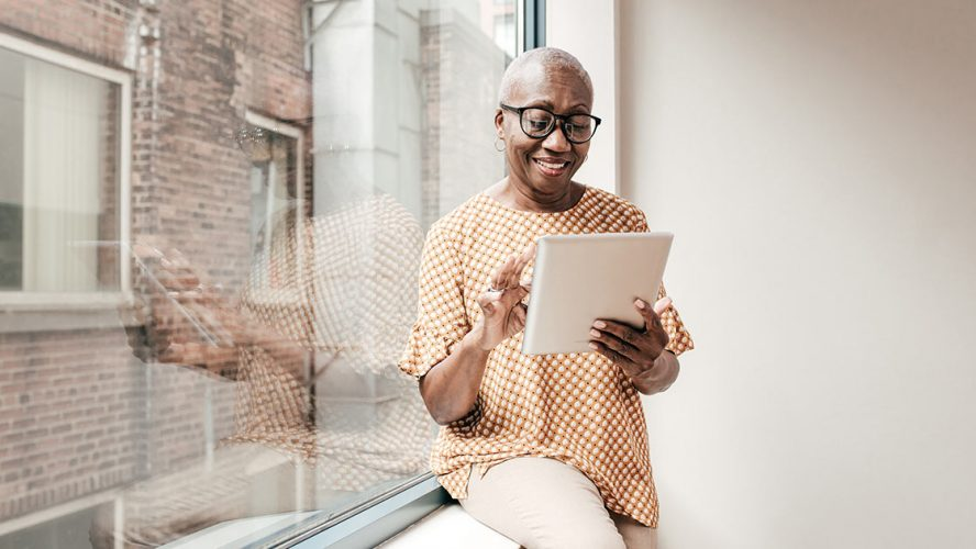 Senior woman using a digital tablet at home