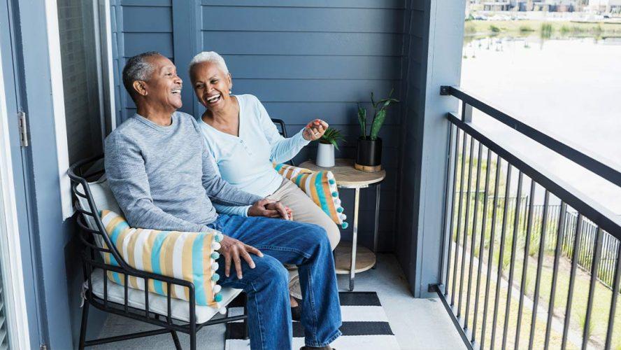 Two seniors enjoying time on their porch