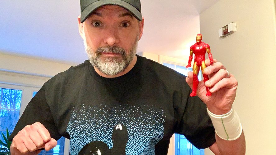 Steven Gallagher holding Iron Man Figurine