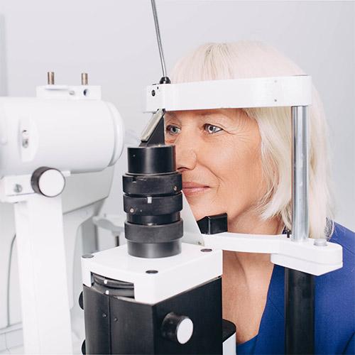 Senior woman receiving an eye exam