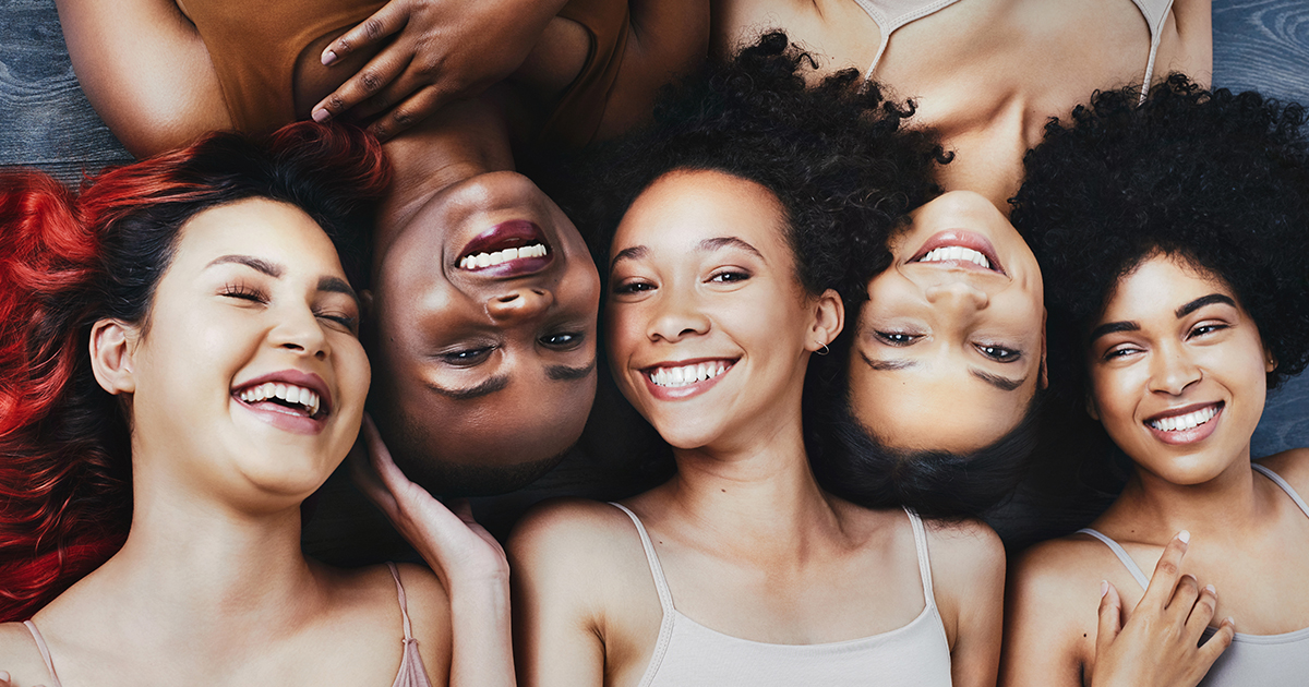 5 girls showing their healthy and beautiful smiles for the camera