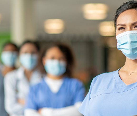 A group of female healthcare professionals with masks on
