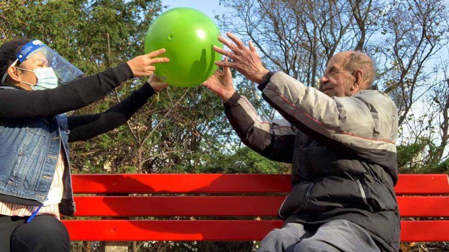 A nurse helping a senior citizen stay active