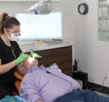 Candice-Boyce-Dental-Hygienist-doing-a-dental-check-up-of-Brian-Arundale-an-oral-cancer-survivor
