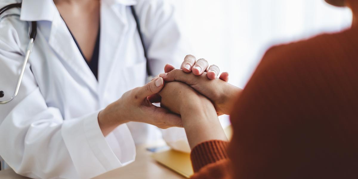 Doctor Holding Patients Hands