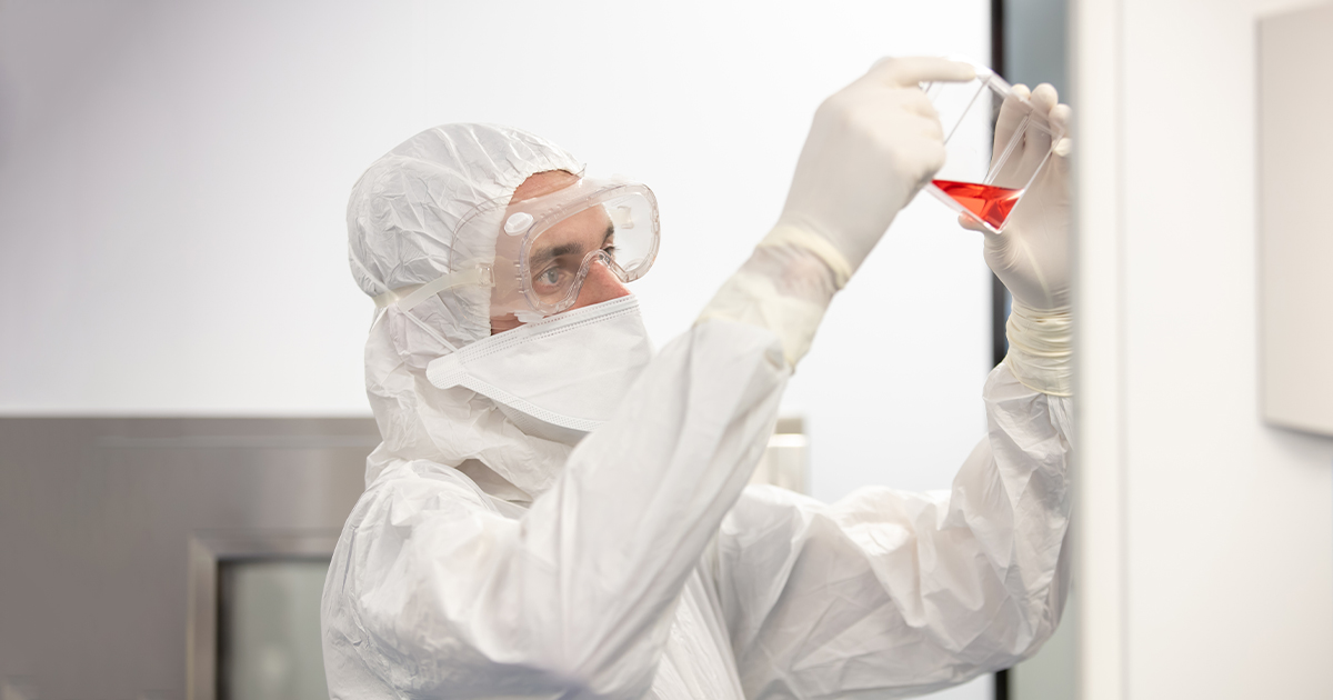 Operator in clean room at CCRM's Centre for Cell and Vector Production in Toronto