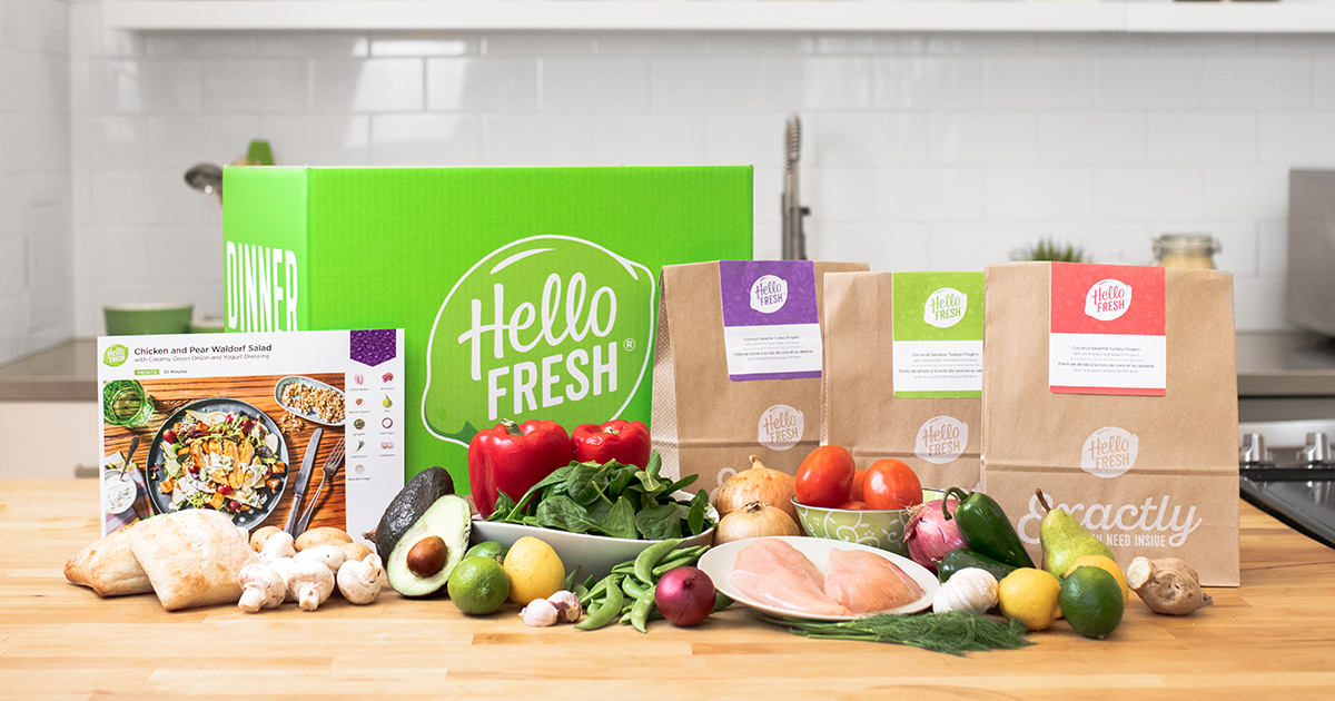 Several Hello Fresh Meal Kits are laid out on the table
