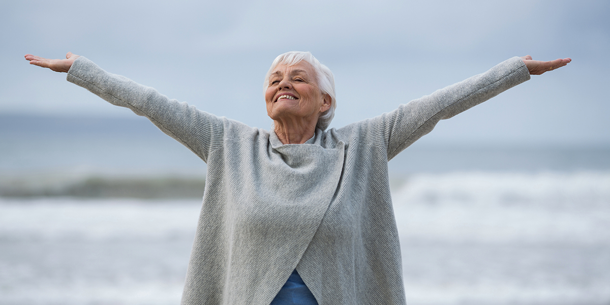 Happy Elderly Woman With Hands Up