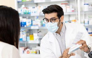 man pharmacist prescribing medication