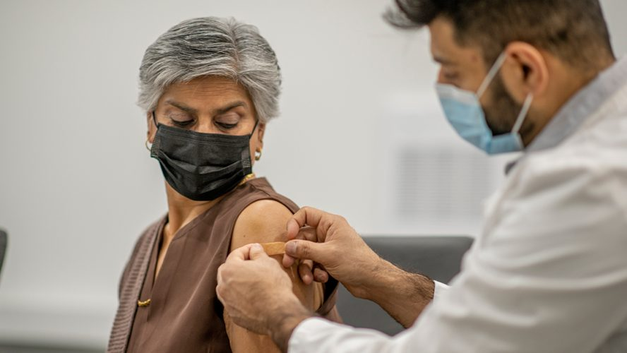 Doctor giving a patient a vaccine shot