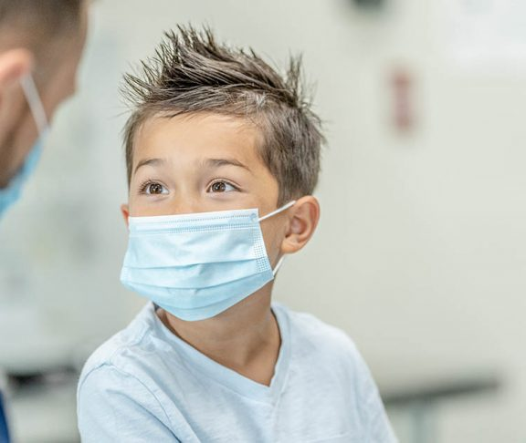 Paediatrician doctors appointment with young boy